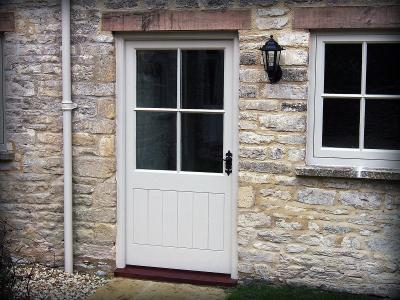 Half glazed door with bars