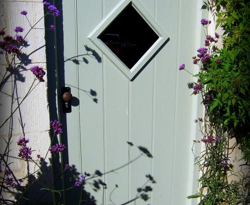 Painted boarded door with diamond vision panel